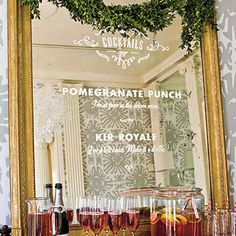 Unexpected Bar Menu from Southern Living.  Apply lettered decals to mirror to create.  Letters can be easily removed after party with no permanent damage to mirror.  Could do this with appetizer station or dinner menu for buffet too.