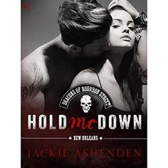 """When the biker who broke her heart rides into town, a woman must choose between passion and duty. Jackie Ashenden ups the ante in a seductive series co-written with Megan Crane, Rachael Johns, and Maisey Yates.  Leonidas """"Blue"""" Delacroix might be the prodigal son of New Orleans aristocrats, but the Deacons of Bourbon Street are his real family. And with their patriarch murdered, Blue wants nothing more than to unleash hell on the motorcycle club's enemies—even if it means taking up arms…"""