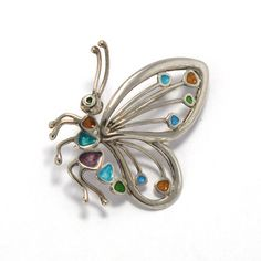 Lovely butterfly brooch in sterling silver and enamel fire, handmade by artisans in Galicia. Tax free $65.90