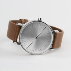 The watch has a 40mm stainless steel case. It features a tan Italian leather strap and holds a Swiss quartz movement. #watches #design