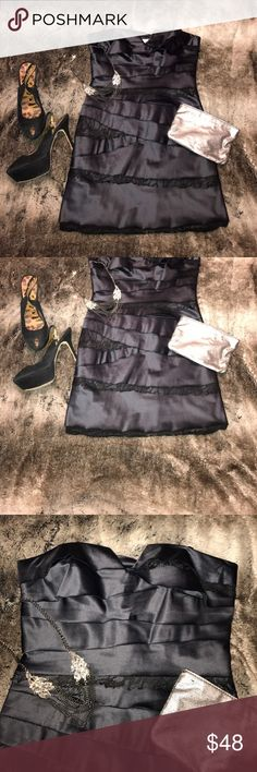 BCBG Black Lace Strapless Dress BCBG Black Lace Strapless Dress. So gorgeous! The dress has layers with lace inlay. Perfect LBD! Gently Worn. Dry Clean Only. This dress has a structured top with piping. So beautiful!! BCBG Dresses Strapless
