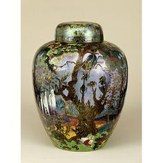"Fairyland Lustre ""Ghostly Wood"" Jar and Cover, 1916 - 1932. The decoration is inspired by the illustrations of ""The Legend of Croquemitaine"" by Gustave Doré, with woods, ghosts, fairies, and goblins."