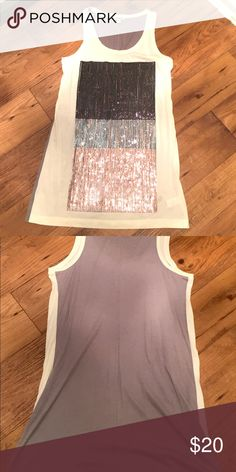 Sequin top Racer back, sequin tunic. Adds the right amount of shimmer to any outfit. Express Tops Tunics