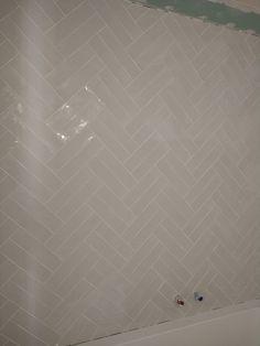 Wandtegelwerk dubbele visgraat
