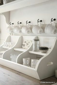 cups in dining room beside china hutch