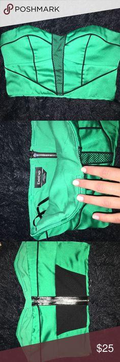 Green Bebe top Green Bebe top with half netting perfect with black skirt! bebe Tops Crop Tops