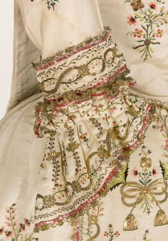 Sleeve detail embroidered as two separate pieces of a Sacque gown a la Piedmontese, ca. 1780, Italy (?), plain cream ribbed silk, metallic and silk embroidery. Metallic lace borders all the embroidery elements.