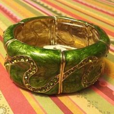 I just discovered this while shopping on Poshmark: Green Bracelet . Check it out!  Size: OS
