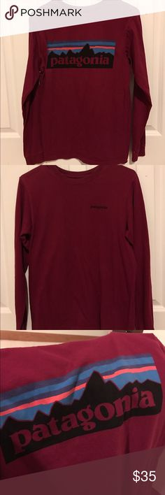 Patagonia Longsleeve Super cute red Patagonia longsleeve shirt! In Men's XS but fits woman S-M. Stitching came out a little as seen in 4th picture but not noticeable when on. Patagonia Tops Tees - Long Sleeve
