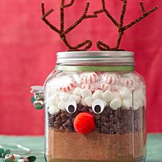 Reindeer Hot Chocolate Mix - Layer hot chocolate mix (1 c sugar, 1 c unsweetened cocoa powder, and 2 c nonfat dry milk powder), chocolate chips, marshmallows, and peppermints in a jar.  Add antlers (brown chenille stem), eyes, and nose (red pom-pom) to make this simple Christmas food gift.