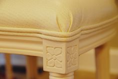 faux ostrich for dining chair: maintainable white upholstery.