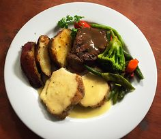 Duo Entree of steak and chicken with baked potatoes and seasonal veggies
