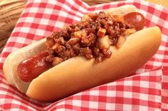 Coney Island Hot Dogs recipe - These hot dogs topped with a mixture of ground beef, onions, tomato sauce and chili powder deliver quintessential amusement park flavor.