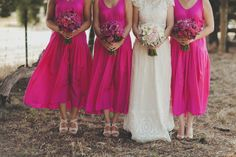 bright pink bridesmaids dresses beauitful! and stunning wedding dress U can see the shoes they'll b wearing :)