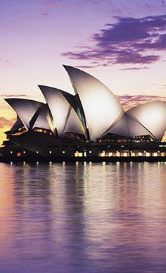 The iconic Sydney Opera House puts on world-class operas, plays, concerts and dance performances annually. Awesome architecture to see in person! Oh The Places You'll Go, Places To Travel, Places To Visit, Beautiful Buildings, Beautiful Places, Monuments, Taj Mahal, City By The Sea, Fiji Water