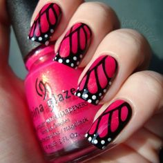Butterfly Wings: Color  your whole nail any Color you want. Then make half of a u shape on your nail in black. Make lines. Then let everything dry. Draw dots with white nail polish and your done!