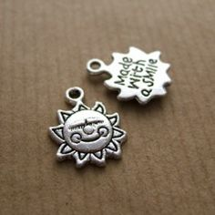 Tibetan silver 'made with a smile' charm.