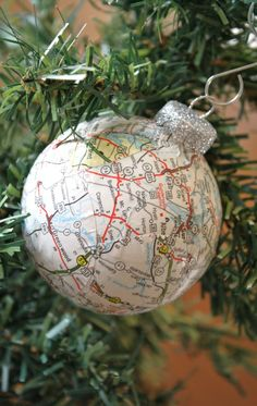Create a map ball ornament with a map of your honeymoon destination, where you got married, your first house, or other romantic or favorite spaces. from A Diamond in the Stuff