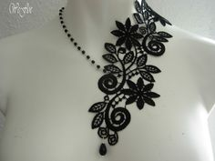Beautiful choker in black, made of lace and pearls black, asymmetrically    Description: left floral lace black, right side small ball necklace silver black Metal silver plated    Handmade textile creation, featuring  Vintage black lace   Fastens with a secure clasp and extension chain Elegant packaging included