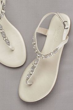 Pearls and crystals lend romantic detail to these versatile sandals.   By David\'s Bridal  Synthetic  Adjustable buckle  Imported