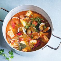 If you can't linguiça, a smoked Portuguese pork sausage, use any high-quality fresh spicy Italian sausage for this Portuguese fish and sausage stew recipe.