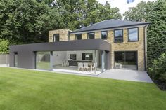 Images: Martin Gardner www.martingardner.com Description: Richmond House was a small and unattractive 4 bed house; it was built from London stock in a neo-Georgian style. The clients' instructed AR Design Studio to re-design and extend the property. The brief was to introduce a new master bedroom, a walk-in wardrobe, a large living space and a kitchen with strong links to the garden.
