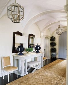 Blue door, arches, lighting and   entry table = love!