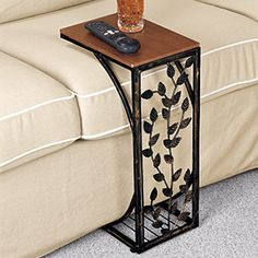 17) Sofa Side Table - This handy side table slides neatly up to sofa or chair to provide the perfect flat surface for a beverage, snack or remote control. Beautiful upright table includes a wooden top with dark stain finish, burnished metal sides and intricate leaf metalwork. $29.98 CAD