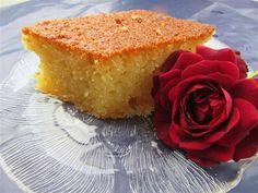 Κοινοποιήστε στο Facebook Υλικά 1 Πακέτο σιμιγδάλι χονδρό 1 κούπα αλεύρι 1 κούπα φρέσκο βούτυρο αγελάδος ή φυτίνη 3/4 κούπες ζάχαρη 4 αυγά 1 κεσεδάκι γιαούρτι 2 κουταλάκια του γλυκού μπέικιν πάουντερ 1 κουτ του γλυκού σόδα Ξύσμα πορτοκαλιού Σιρόπι...