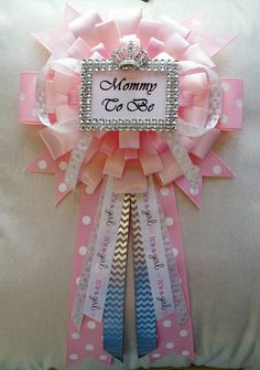 Available in several colors, this big, beautiful baby shower corsage measures 8 X 11 and will most definitely make the Mommy-To-Be feel like the queen of the party! It features a handmade faux rhinestone framed Mommy To Be sign with a rhinestone jeweled crown accessory.  Please request alternative color choices in a message to the seller. I will do my best to accommodate your preferences