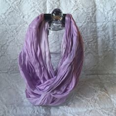 Variegated lavender infinity scarf Variegated lavender infinity scarf. Close-up of the fabric in pictures two and three you can see the variations of the lavender. Picture 4 has the fabric content. Eyeful Accessories Scarves & Wraps