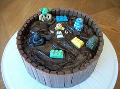Star Wars Mud-pit Piñata Cake - chocolate fudge cake with chocolate ganache and M&Ms in the center!