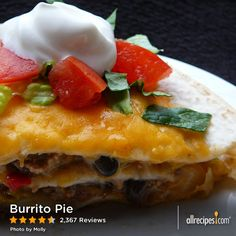 Burrito Pie | Ground beef, refried beans and tomatoes are layered in a casserole with tortillas and cheese, and baked.