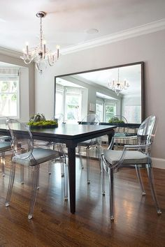 Chic dining room features walls painted a gorgeous light gray, Benjamin Moore Thunder, lined with ...
