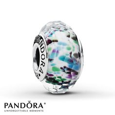 Abstract turquoise patterns swim in a white Murano glass center in this sterling silver charm from the Summer 2013 collection from Pandora. Style # 791610.