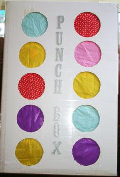 "It's called a ""Punch Box"" and it's a great alternative to a pinata. (Four-year-olds with big sticks can be a little scary sometimes.) Instead of beating on a pinata with a stick, each child punches through one of the pretty colored circles in order to grab the prize inside."