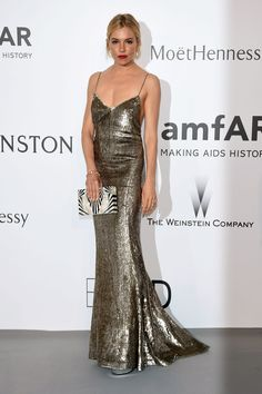 Sienna Miller in a Ralph Lauren gold sequin gown - amfAR Cinema Against AIDS Gala, click through for the full gallery