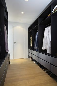 Industrial modern interior design, walk in wardrobe. The Canal House renovated by HI-MACS® and designed by Witteveen Architects. Currently being featured on www.martynwhitedesigns.com