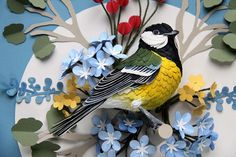 Bird Stamps: Intricate paper-cut artworks of birds that seem to leap off postage stamps