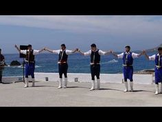 Traditional Cretan Music and Dance Group performing outside of the Xenia Hotel in Chora Sfakion, Crete in front of the Libyan Sea in May By Sfakia-Cret. Greek Traditional Dress, Travel Advise, Greek Music, My Land, Greek Islands, Crete, Clouds, Dance, History