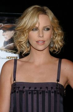 Charlize Theron waves