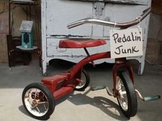 This is the same trike as mine! Could hang a old chalkboard or sign from front and flowers in seat of it for garden