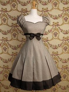 Love the sleeves, the sweetheart neckline, the little black bow, and the bottom!