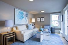 One of the home's lower level bedrooms has a sitting area with access to the patio and a separate street entrance. Photo: OpenHomesPhotography.com