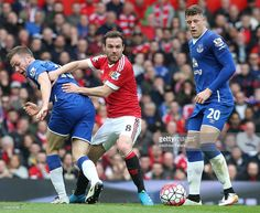 Juan Mata of Manchester United in action with during Tom Cleverley of Everton during the Barclays Premier League match between Manchester United and Everton at Old Trafford on April 3, 2016 in Manchester, England.