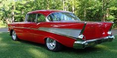 1957 Chevy Bel Air, Red. Brand new car my dad bought when I was about 2 years old. We moved few years later & he had it painted black. I loved that car. Wish I had it today.