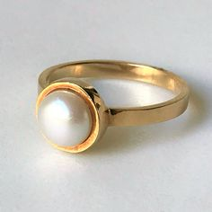 Yellow Gold & Pearl Ring The modern yellow gold ring is set with a white diameter freshwater pearl in a tube setting, and the band is stamped Weight Age Circa 2000 Dimensions Approximat Gold Pearl Ring, Vintage Jewellery, Yellow Gold Rings, Wedding Rings, Engagement Rings, Pearls, Band, Antiques, Jewelry
