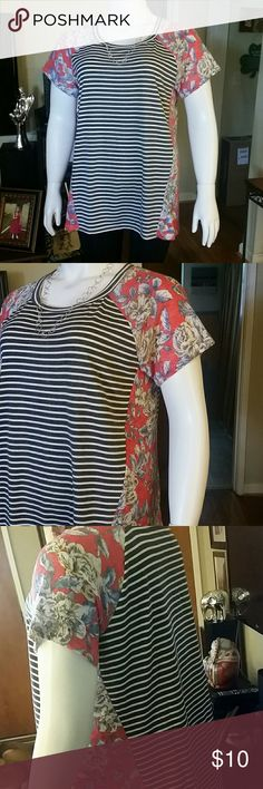 Beautiful tunic! Black and white stripes with red floral design.  Polyester / rayon blend. Oddy Tops Tunics