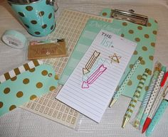 This listing is for a mint and gold with a bit of pink planner desk kit. Items include a pencil pail, tags, note pads, washi tape, small