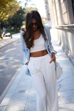 blue blazer with a white crop-top & white pants